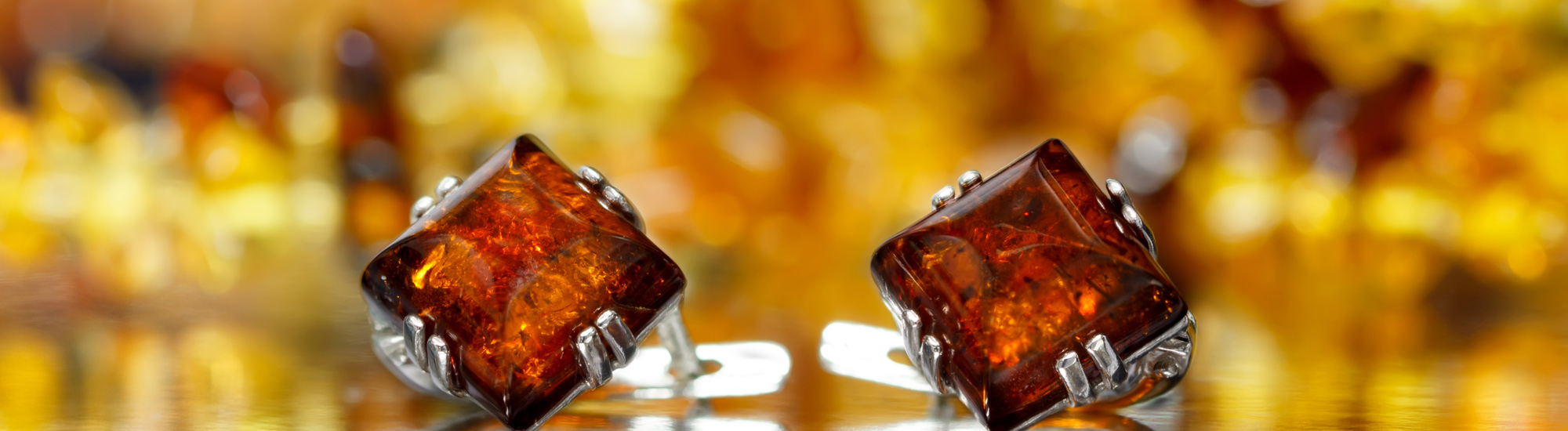 Closeup of Silver Earrings With Baltic Amber